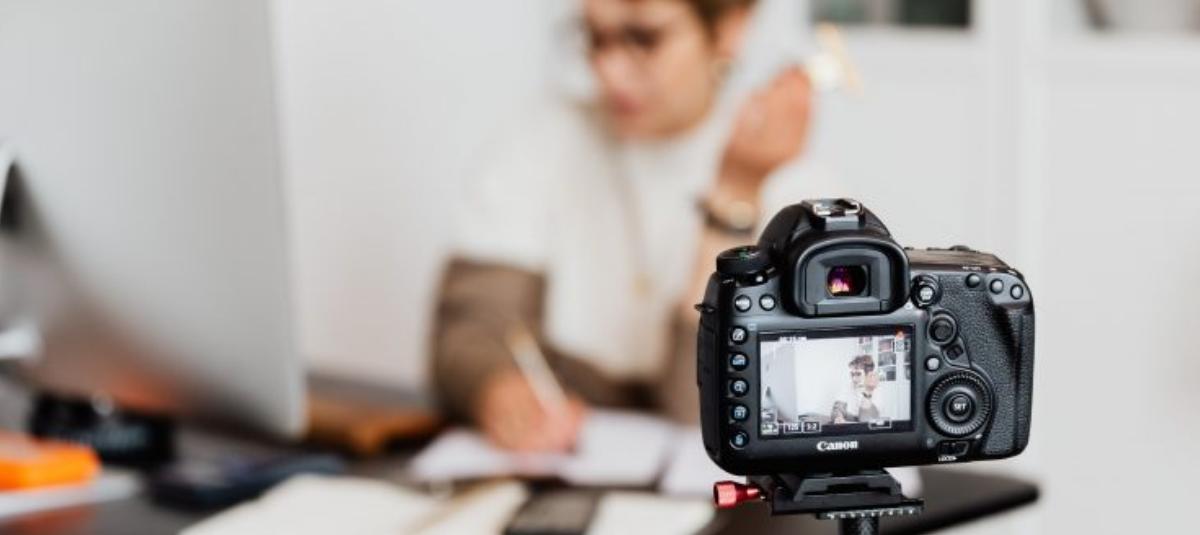 woman filming herself on tripod camera