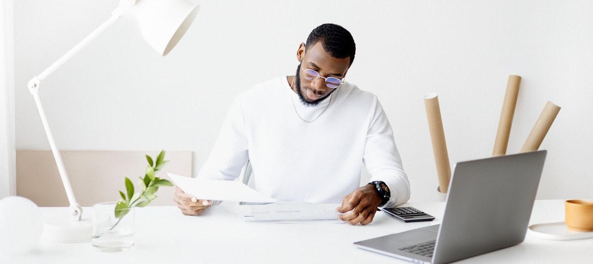 man in white at desk