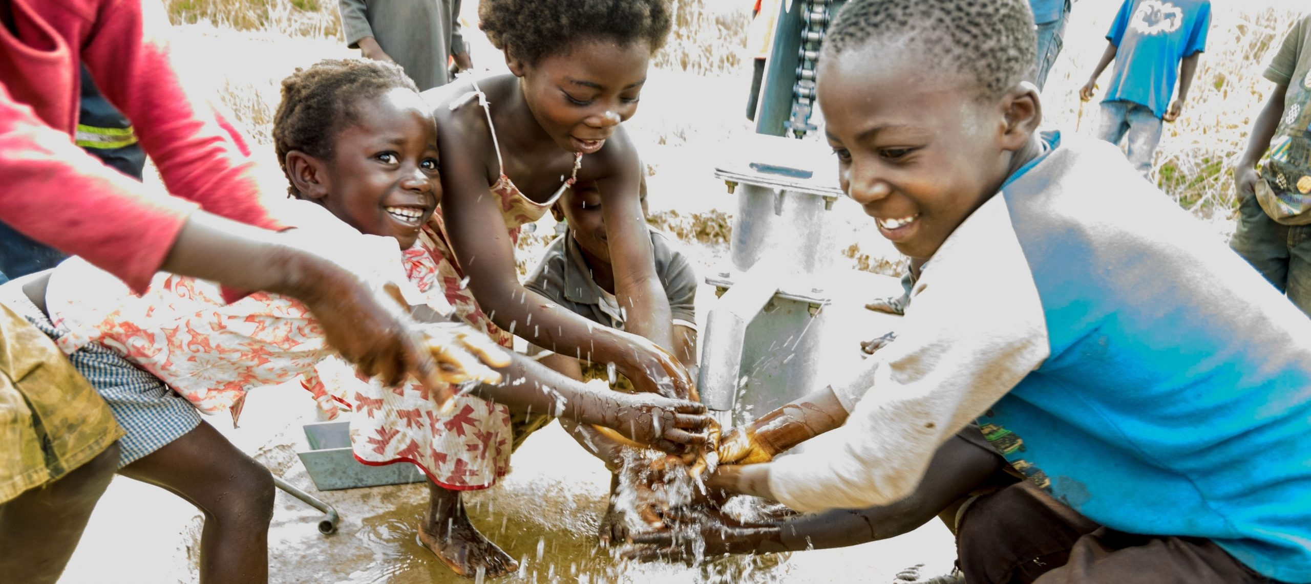 young children at a water fountain