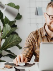 man scrolling on laptop