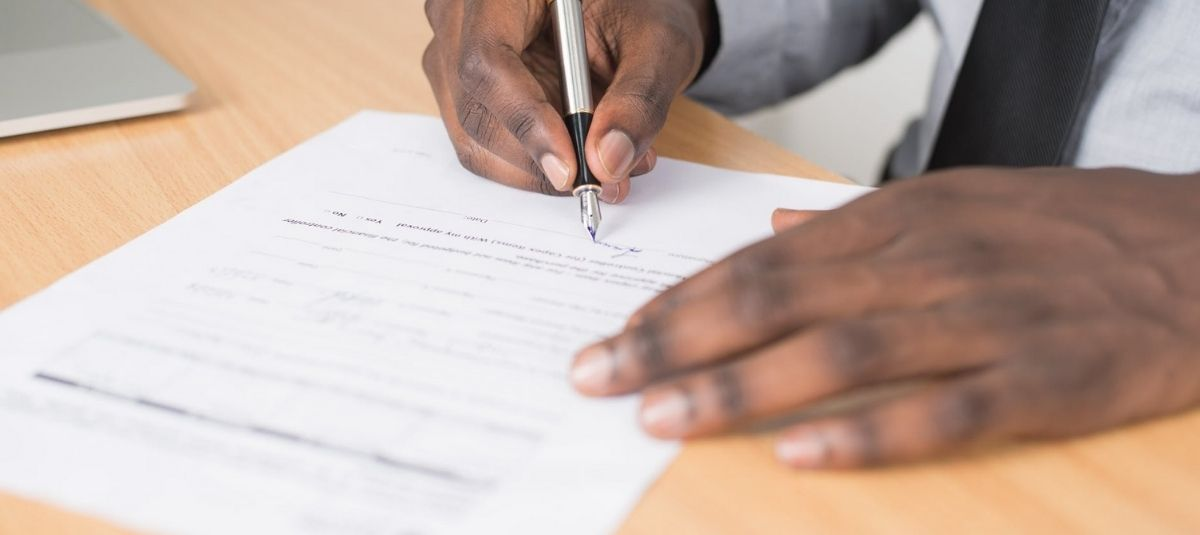 person filling out grant proposal form