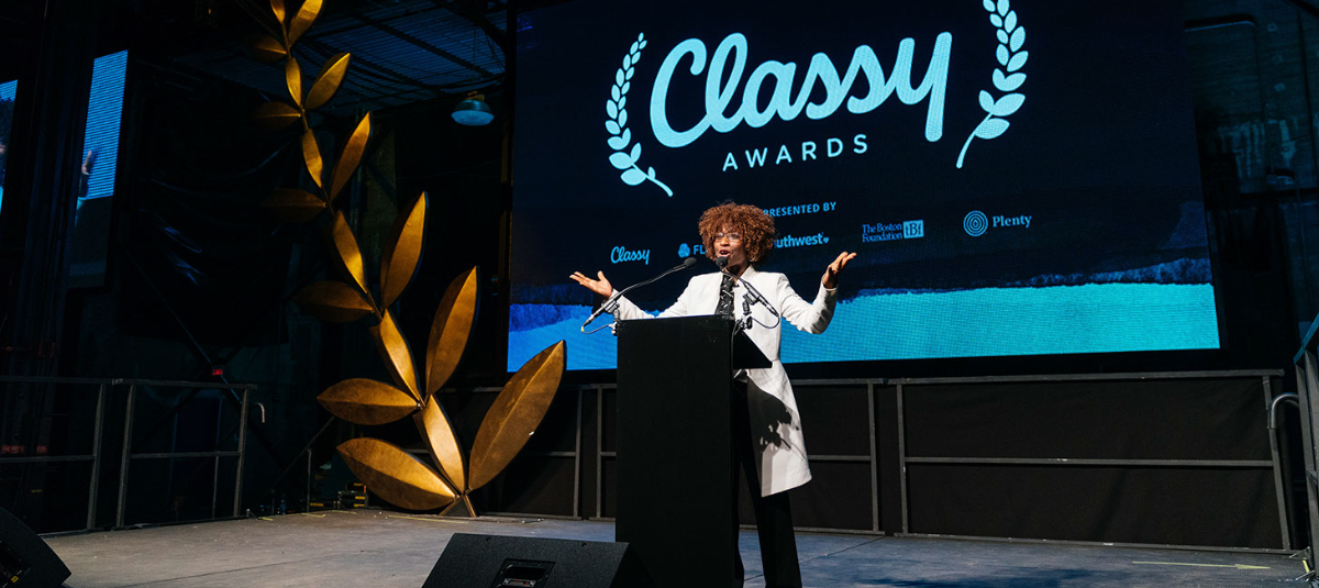 woman on stage at classy awards ceremony