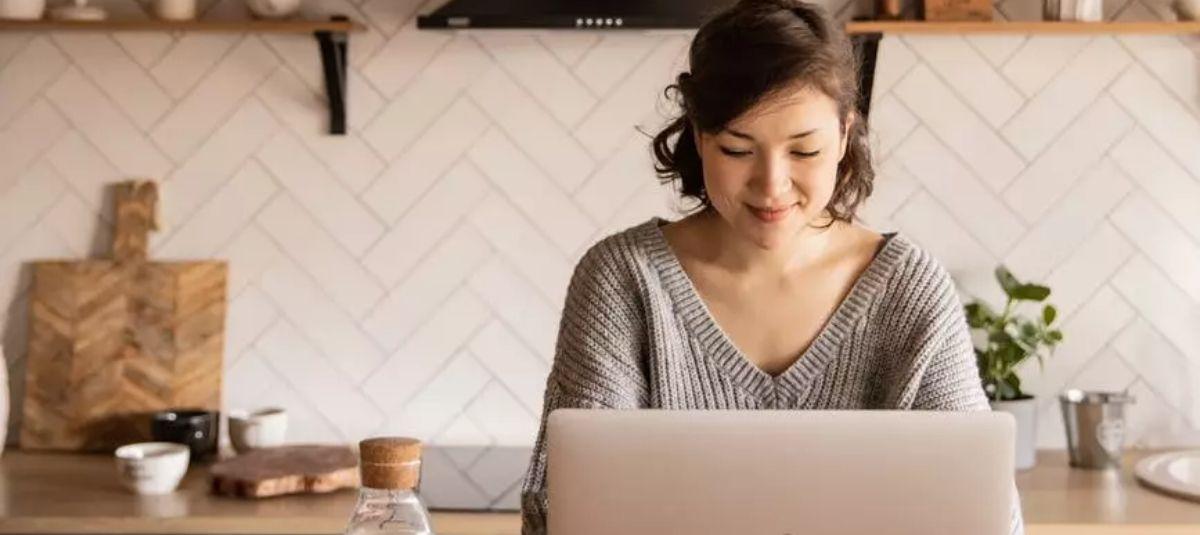 woman smiling at work laptop